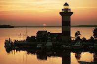 """<p><strong>Hilton Head</strong></p><p><a href=""""https://www.hiltonheadisland.org/"""" rel=""""nofollow noopener"""" target=""""_blank"""" data-ylk=""""slk:Hilton Head"""" class=""""link rapid-noclick-resp"""">Hilton Head</a> in South Carolina is an oasis without traveling across the world. America's favorite island is home to 12 miles of pristine beaches and the finest southern dining. Whether you're seeking spa days or surfing days, there's something for everyone.</p>"""