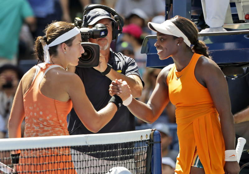 Anastasija Sevastova left of Latvia shakes hands with Sloane Stephens after Sevastova defeated Stephens during the quarterfinals of the U.S. Open tennis tournament Tuesday Sept. 4 2018 in New York