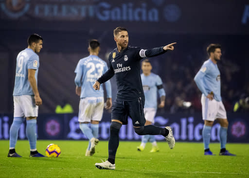Real Madrid's Sergio Ramos after scoring the third goal during a Spanish La Liga soccer match between RC Celta and Real Madrid at the Balaidos stadium in Vigo, Spain, Sunday, November 11, 2018. (AP Photo/Lalo R. Villar)