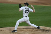 Chicago White Sox starter Lucas Giolito delivers a pitch during the first inning of a baseball game against the Cleveland Indians Tuesday, April 13, 2021, in Chicago. (AP Photo/Paul Beaty)