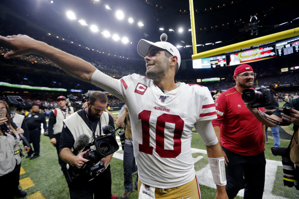 San Francisco 49ers quarterback Jimmy Garoppolo (10) celebrates after an NFL football game against the New Orleans Saints in New Orleans, Sunday, Dec. 8, 2019. The 49ers won 48-46. (AP Photo/Brett Duke)