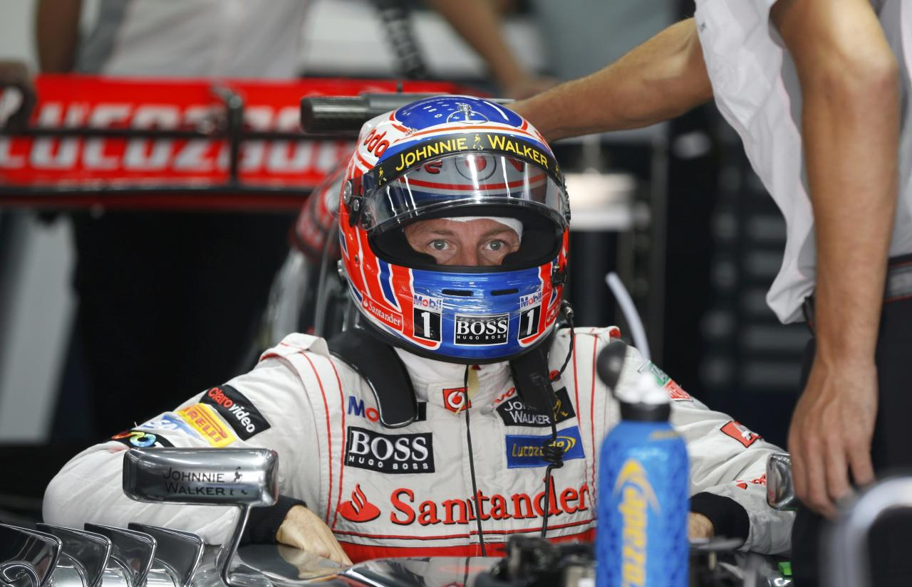 McLaren Formula One driver Jenson Button of Britain sits in his car during the second practice session of the Korean F1 Grand Prix at the Korea International Circuit in Yeongam October 4, 2013. REUTERS/Kim Hong-Ji (SOUTH KOREA - Tags: SPORT MOTORSPORT F1)