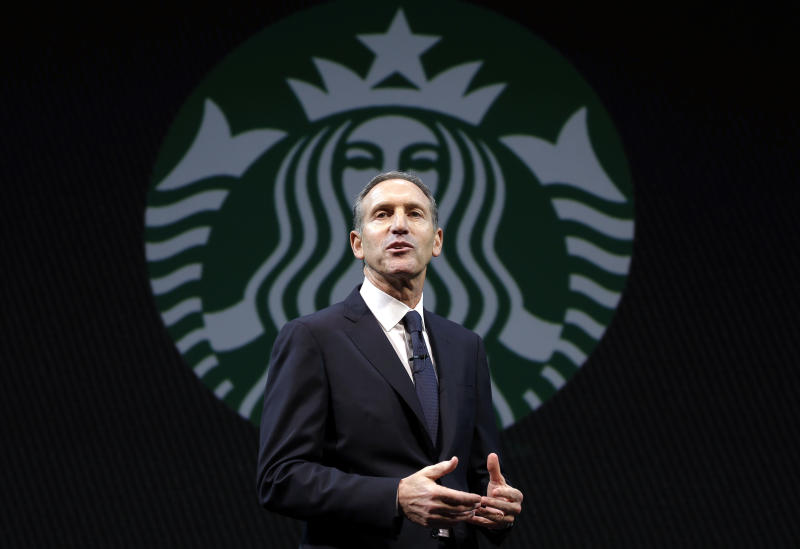 FILE - In this  Wednesday, March 20, 2013, file photo, Starbucks CEO Howard Schultz speaks at the company's annual shareholders meeting,in Seattle, Wash. Starbucks Corp. reports quarterly financial results after the market closes on Thursday, April 25, 2013. (AP Photo/Ted S. Warren)