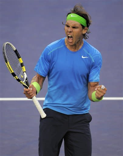 Rafael Nadal of Spain, celebrates after defeating David Nalbandian of Argentina, 4-6, 7-5, 6-4 in their match at the BNP Paribas Open tennis tournament, Friday, March 16, 2012, in Indian Wells, Calif. (AP Photo/Mark J. Terrill)