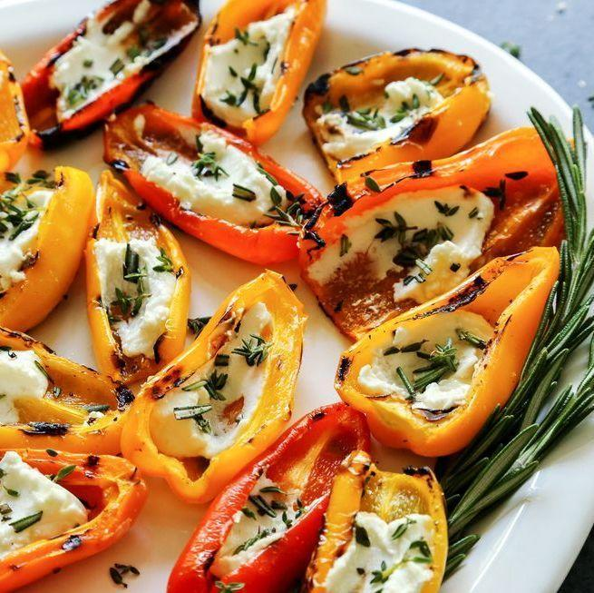 """<p>The key to nailing this Instagram-ready appetizer? Shop for a variety of multi-colored mini peppers. </p><p><strong><a href=""""https://www.thepioneerwoman.com/food-cooking/recipes/a94462/grilled-mini-sweet-peppers-with-goat-cheese/"""" rel=""""nofollow noopener"""" target=""""_blank"""" data-ylk=""""slk:Get the recipe"""" class=""""link rapid-noclick-resp"""">Get the recipe</a>.</strong></p><p><a class=""""link rapid-noclick-resp"""" href=""""https://go.redirectingat.com?id=74968X1596630&url=https%3A%2F%2Fwww.walmart.com%2Fsearch%2F%3Fquery%3Dpioneer%2Bwoman%2Bknives&sref=https%3A%2F%2Fwww.thepioneerwoman.com%2Ffood-cooking%2Fmeals-menus%2Fg36004463%2Fmemorial-day-appetizers%2F"""" rel=""""nofollow noopener"""" target=""""_blank"""" data-ylk=""""slk:SHOP KNIVES"""">SHOP KNIVES</a></p>"""