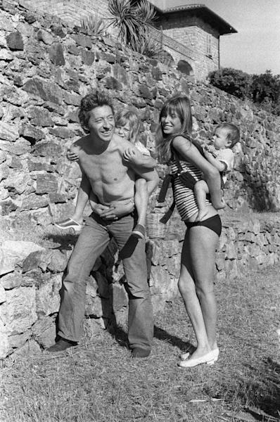 Jane Birkin and Serge Gainsbourg with children Kate, four, and Charlotte, one, during their vacation at Ramatuelle castle in Saint Tropez in 1972
