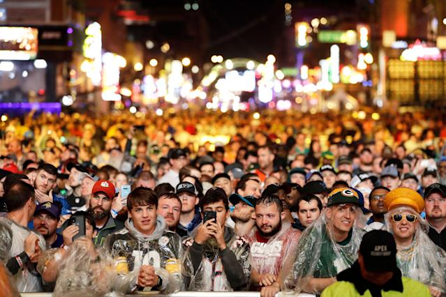Fans weathered the storm to watch Round 1 of the NFL draft on Thursday. The forecast should be nicer for Rounds 2-3 on Friday evening. (AP)