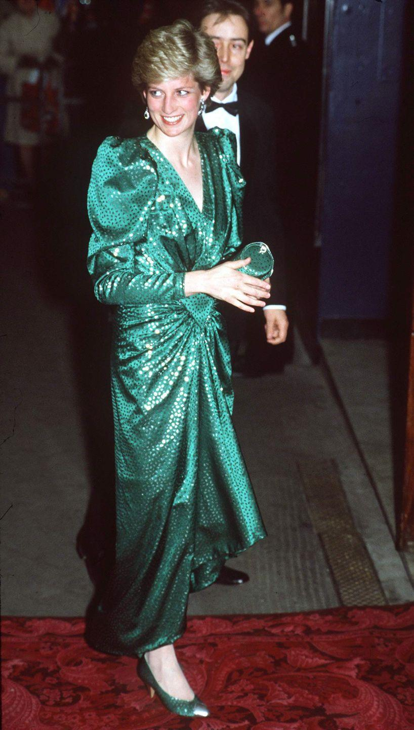 <p>In a sparkling, emerald-green dress and matching clutch at a performance of High Society in London. </p>