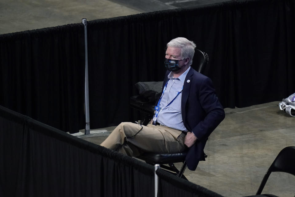 NCAA President Mark Emmert watches the first half of a college basketball game between North Carolina State and South Florida in the second round of the women's NCAA tournament at the Alamodome in San Antonio, Tuesday, March 23, 2021. (AP Photo/Eric Gay)