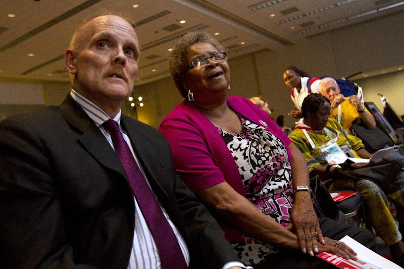 "In this photo taken July 25, 2012, Stephen Karpiak, with the AIDS Community Research Initiative of America, left, and Carolyn Massey, 54, of Laurel, Md., who has HIV, wait for the start of a panel, ""Aging With HIV,"" that they are speaking on at the International AIDS Conference in Washington. AIDS is graying: By the end of the decade, the government estimates, more than half of Americans living with HIV will be over 50. Even in developing countries, more people with the AIDS virus are surviving to middle age and beyond. (AP Photo/Jacquelyn Martin)"