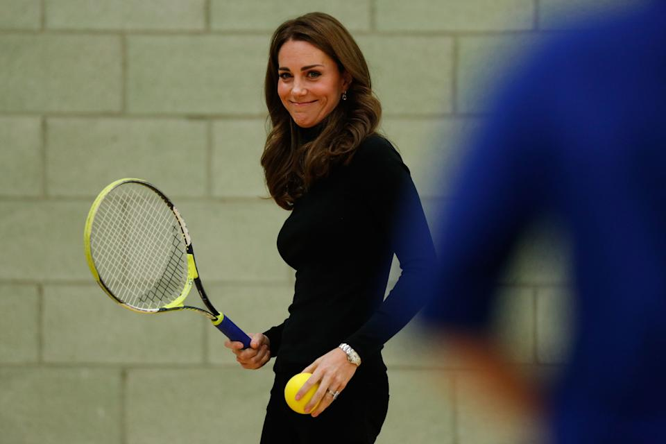 The Duchess of Cambridge plays tennis as she joins a session with a group during a visit to Coach Core Essex in Basildon.