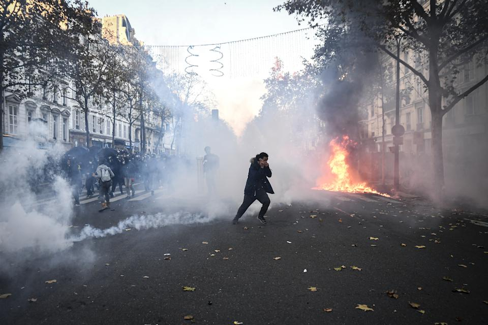 PARIS, FRANCE - NOVEMBER 28: Clashes erupt as police use tear gar to disperse protesters during a demonstration against the newly passed controversial global security law, in Paris, France, on November 28, 2020. The global security legislation passed by the French Parliament aims to ban the distribution of photos in which police officers and gendarmes can be identified in a way which is harmful to their image. (Photo by Julien Mattia/Anadolu Agency via Getty Images)