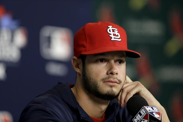 St. Louis Cardinals pitcher Joe Kelly listens to a question during a baseball news conference Friday, Oct. 25, 2013, in St. Louis. Kelly is set to start for the Cardinals when they play the Boston Red Sox in Game 3 of the World Series scheduled for Saturday in St. Louis. (AP Photo/Jeff Roberson)