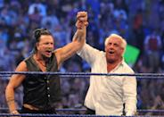 """""""Nature Boy"""" Ric Flair raises the arm of actor Mickey Rourke after he knocked out Chris Jericho at WrestleMania 25 at the Reliant Stadium on April 5, 2009 in Houston, Texas. (Photo by George Napolitano/FilmMagic)"""