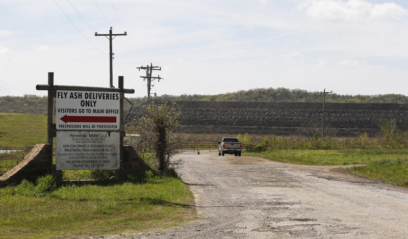 This April 8, 2019, photo, shows a coal-waste dump site in Bokoshe, Okla. Residents of Bokoshe have been worried for years about coal-ash contamination. Now the Environmental Protection Agency has approved Oklahoma to be the first state to take over enforcement on coal-ash sites. (AP Photo/Sue Ogrocki)
