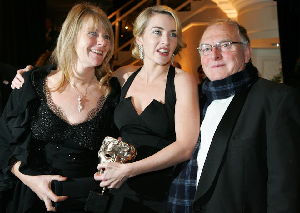 British actress Kate Winslet, center, with her parents Sally Bridges-Winslet, left, and Roger Winslet, right, at the British Academy Film Awards 2009 after party at The Grosvenor Hotel in London, England, Sunday, Feb. 8, 2009. (AP Photo/Alastair Grant)
