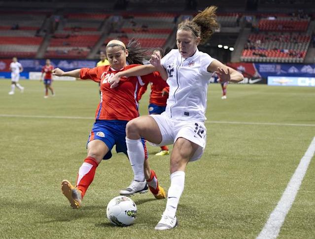 VANCOUVER, CANADA - JANUARY 27: Lauren Cheney #12 of the United States beats Wendy Acosta #20 of Costa Rica to the loose ball during the first half of semifinals action of the 2012 CONCACAF WomenÕs Olympic Qualifying Tournament at BC Place on January 27, 2012 in Vancouver, British Columbia, Canada. (Photo by Rich Lam/Getty Images)