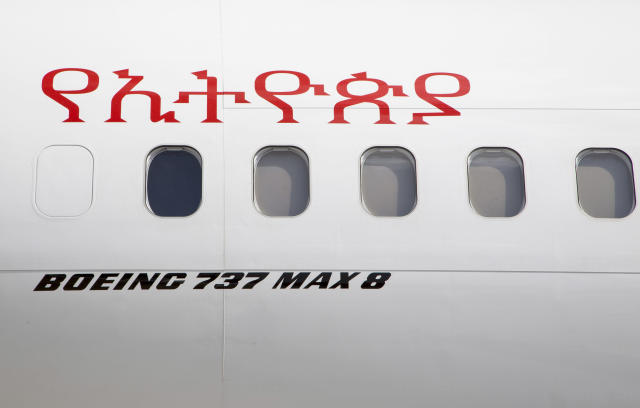 """An Ethiopian Airlines Boeing 737 Max 8 sits grounded at Bole International Airport in Addis Ababa, Ethiopia Saturday, March 23, 2019. The chief of Ethiopian Airlines says the warning and training requirements set for the now-grounded 737 Max aircraft may not have been enough following the Ethiopian Airlines plane crash that killed 157 people. Writing in Amharic reads """"Ethiopian"""". (AP Photo/Mulugeta Ayene)"""