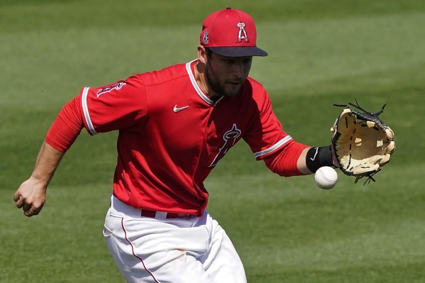 Los Angeles Angels' David Fletcher fields a base hit by Oakland Athletics' Elvis Andrus during the third inning of a spring training baseball game, Saturday, March 20, 2021, in Tempe, Ariz. (AP Photo/Matt York)