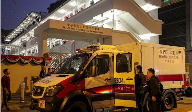 One of the suspects was taken to S K H St Simon's Lui Ming Choi Secondary School in Tuen Mun. Photo: Winson Wong