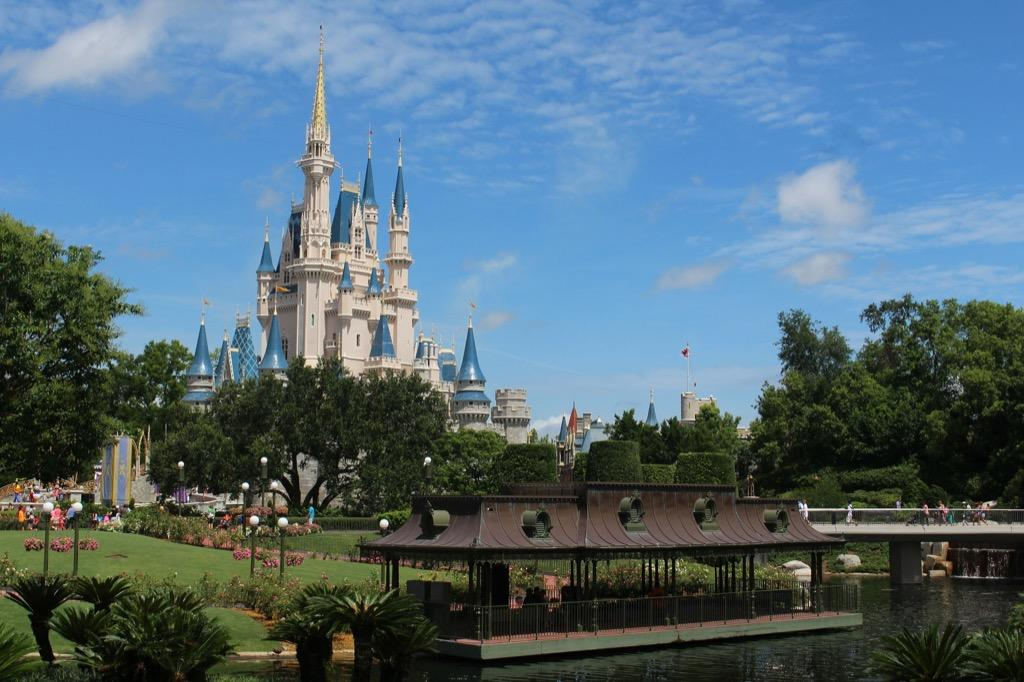 """A family consisting of two adults and two children over the age of 3 can expect to shell out $5,165 on a trip to the <a href=""""https://bestlifeonline.com/whimsical-disney-world-facts/?utm_source=yahoo-news&utm_medium=feed&utm_campaign=yahoo-feed"""">legendary Walt Disney World</a> in Orlando, Florida.  If you book a five-day June excursion and stay at the<a href=""""https://disneyworld.disney.go.com/resorts/port-orleans-resort-riverside/rates-rooms/room-only/"""" target=""""_blank"""">Port Orleans resort</a>, a moderately-priced in-park resort, a room with two queen beds will cost around $291 per night, or $1,455 for a five nights.  You'll likely want to visit most of the parks that Walt Disney World has to offer: Magic Kingdom, Animal Kingdom, Epcot, and Hollywood Studios, along with two water parks. So a <a href=""""https://disneyworld.disney.go.com/admission/tickets/"""" target=""""_blank"""">standard ticket with the park hopper option</a> that allows visitors to jump between the different parks comes to $109 per person per day. That means you'll be forking over $2,180 just on admission. (As with most hotels and theme park tickets, these prices fluctuate throughout the year.)  And if your four-person family opts for one of the park's character meals (around $160), and throws in the Disney dining plan (approximately $207 for the family per day), you'll spend about $1,195 on food over the course of five days. Since you'll likely buy souvenirs and other extras, you can expect to add approximately $75 per day ($375 all told) to your total. (Of course, this doesn't include your flights to Walt Disney World, car rental fees, or any activities you may choose to pursue outside of the park.)  The good news? Those visiting the legendary park on a shoestring budget can save hundreds by staying at a hotel outside of the park, bringing in their own food (yes, you're permitted to do so), and opting out of the park hopper option. And for more Disney budgeting tips, check out the <a href=""""https://bestlifeo"""