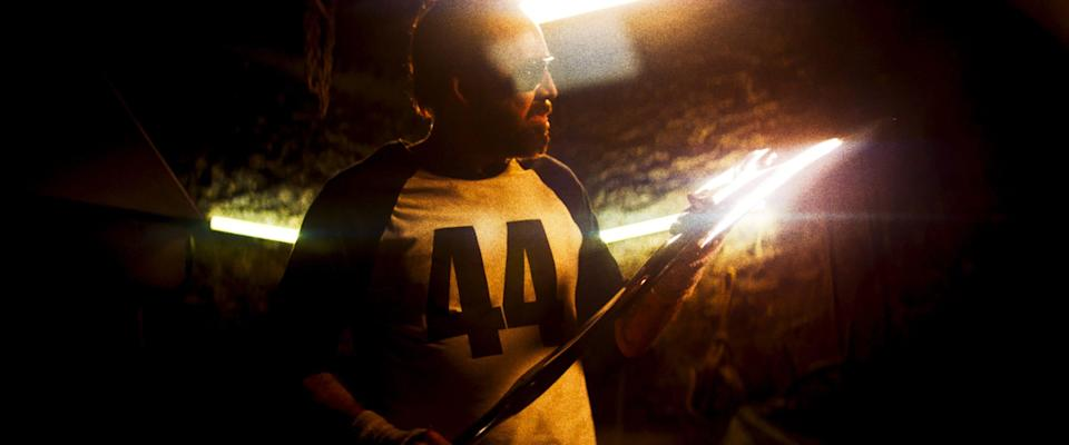 """Red (Nicolas Cage) prepares for war by forging a destructive ax in the fantasy thriller """"Mandy."""""""