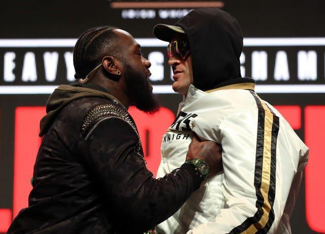 Tyson Fury, left, will take on Deontay Wilder for a third time in October (Bradley Collyer/PA)
