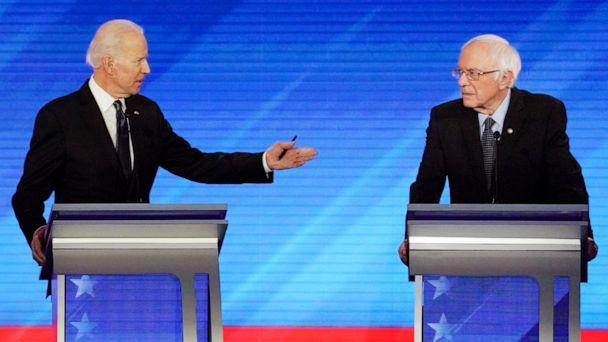 PHOTO: Democratic 2020 U.S. presidential candidate and former Vice President Joe Biden gestures towards Senator Bernie Sanders during the eighth Democratic 2020 presidential debate at Saint Anselm College in Manchester, New Hampshire, February 7, 2020. (Brian Snyder/Reuters)