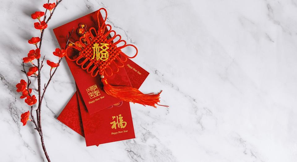 Red envelopes containing money are often given as gifts to children (Getty)