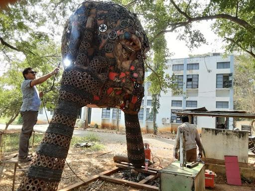 Stills of Srinivas Padakandla working on the sculpture.