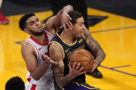 Los Angeles Lakers forward Kyle Kuzma, right, tries to shoot as Houston Rockets forward Anthony Lamb defends during the second half of an NBA basketball game Wednesday, May 12, 2021, in Los Angeles. (AP Photo/Mark J. Terrill)