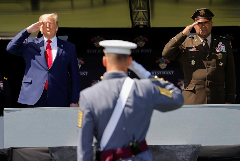 U.S. President Donald Trump salutes alongside U.S. Army Lieutenant General Darryl Williams, the Superintendent of the U.S. Military Academy at West Point, as he prepares to deliver the commencement address at the 2020 United States Military Academy Graduation Ceremony in West Point, New York, U.S., June 13, 2020.  REUTERS/Mike Segar