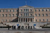 Greece secures deal to unlock 12 bn euros bailout funds