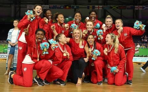 England and head coach Tracey Neville and the team celebrate winning gold at the 2018 Commonwealth Games - Credit: GETTY IMAGES