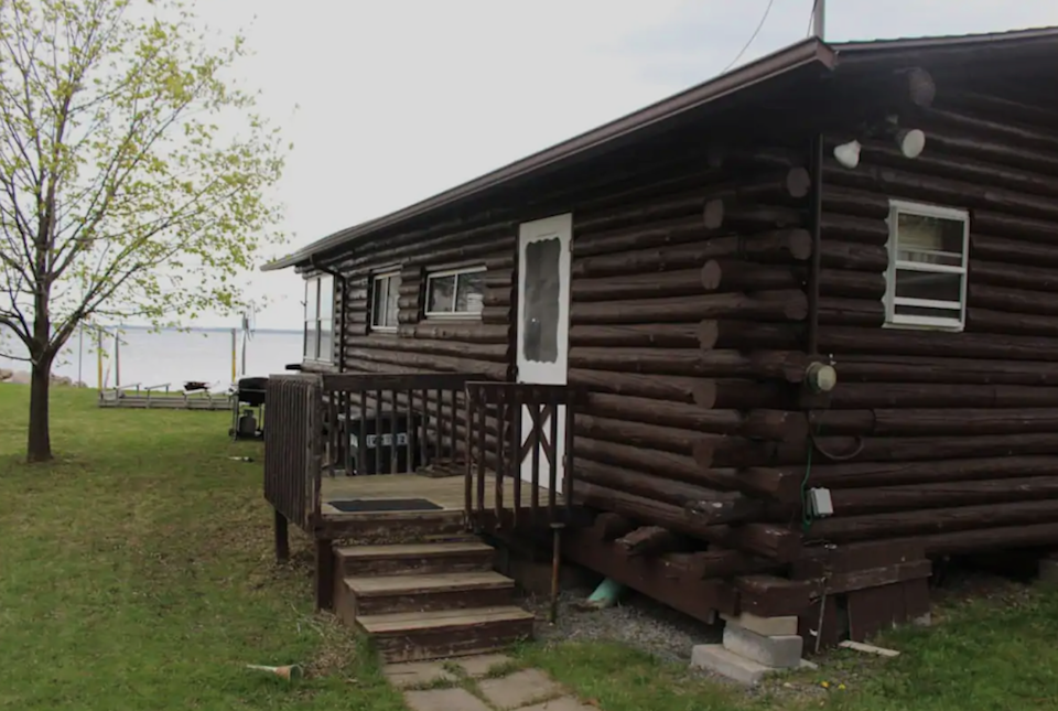 """<h2>Lake Champlain, New York<br></h2><br><strong>Location</strong>: Plattsburgh, New York<br><strong>Sleeps</strong>: 8<br><strong>Price Per Night</strong>: <a href=""""https://airbnb.pvxt.net/QOjR23"""" rel=""""nofollow noopener"""" target=""""_blank"""" data-ylk=""""slk:$214"""" class=""""link rapid-noclick-resp"""">$214</a><br><br>""""With private beach access, beautiful views, and a comfortable home to stay in, this property serves as the perfect getaway for friends and family to relax and enjoy the wonderful amenities that Lake Champlain has to offer. The backyard provides enough space for plenty of activities such as sunbathing, picnics, playing games, swimming, fishing, or having a bonfire.""""<br><br><h3>Book <a href=""""https://airbnb.pvxt.net/QOjR23"""" rel=""""nofollow noopener"""" target=""""_blank"""" data-ylk=""""slk:Cozy Log Cabin On Champlain"""" class=""""link rapid-noclick-resp"""">Cozy Log Cabin On Champlain</a></h3>"""