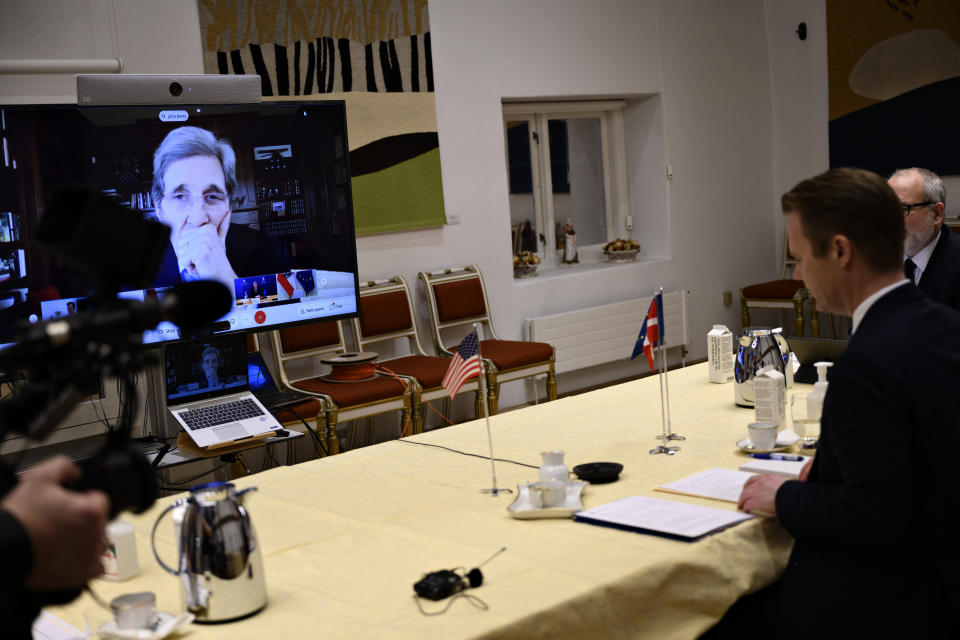 Danish Foreign Minister Jeppe Kofod, right, attends a video conference together with other EU-leaders, meeting with US Special Presidential Envoy for Climate John Kerry, seen on screen, in Copenhagen Denmark, Friday, Jan. 22, 2021.
