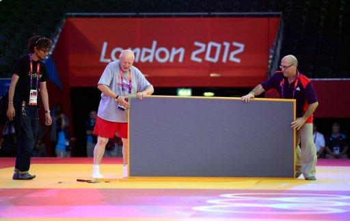 Organisers install tatamis for the judo competition at the Excel centre on July 26 in London, on the eve of the start of the London 2012 Olympic Games. Video replay technology will be used at the Olympic judo competition for the first time in an effort to eradicate judging controversies