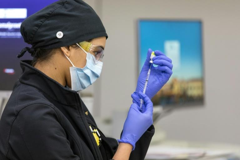 Nurse Komal Kaur prepares a dose of the Pfizer-BioNTech Covid-19 vaccine at the Valley Children's Hospital in Madera, California