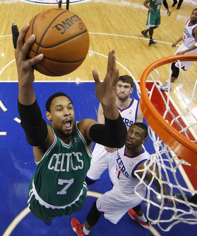 Boston Celtics' Jared Sullinger, left, goes up for the shot as Philadelphia 76ers' Thaddeus Young, bottom right, and Spencer Hawes, upper right, watch during the first half of an NBA basketball game, Wednesday, Feb. 5, 2014, in Philadelphia. (AP Photo/Chris Szagola)