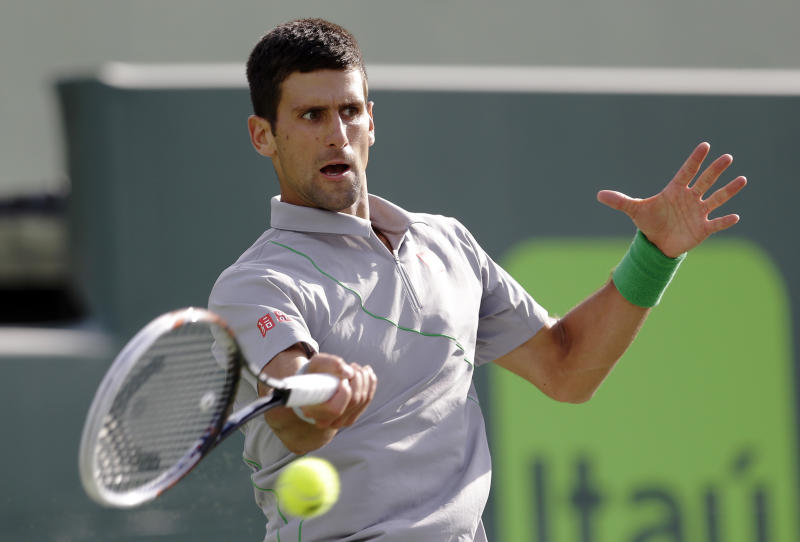 Novak Djokovic, of Serbia, returns to Andy Murray, of Great Britain, at the Sony Open Tennis tournament in Key Biscayne, Fla., Wednesday, March 26, 2014. (AP Photo/Alan Diaz)