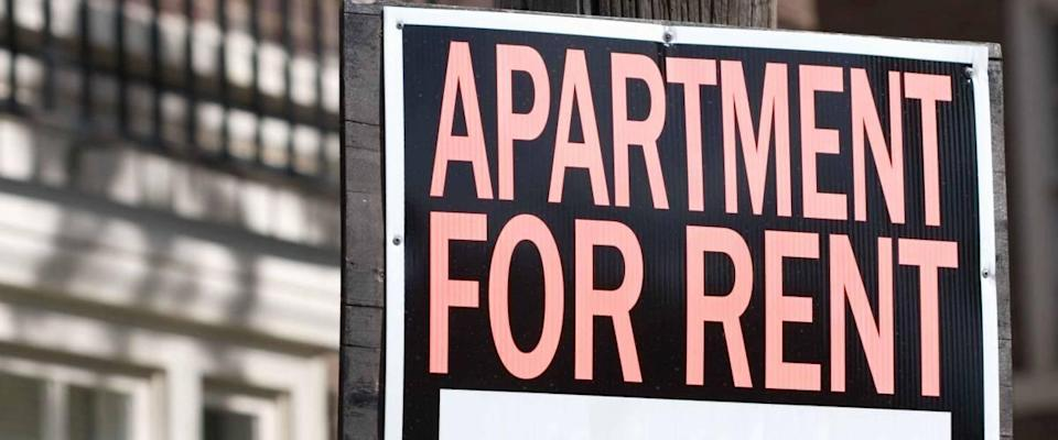 Apartment for rent sign in front of a building