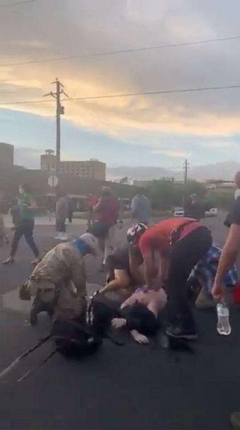 PHOTO: People help a man who was shot and wounded during clashes between a group of armed men and protesters trying to pull down a statue of Spanish conquistador Juan de Onate in Albuquerque, New Mexico, on June 15, 2020. (Courtesy of Fight For Our Lives / Social media via Reuters)