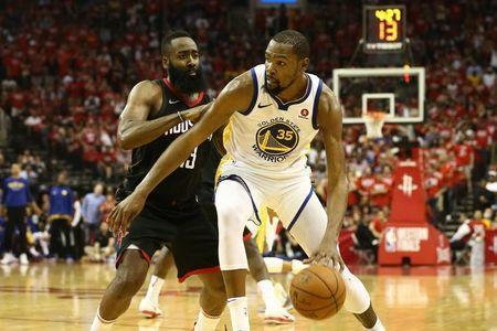 May 14, 2018; Houston, TX, USA; Golden State Warriors forward Kevin Durant (35) dribbles against Houston Rockets guard James Harden (13) during the fourth quarter in game one of the Western conference finals of the 2018 NBA Playoffs at Toyota Center. Mandatory Credit: Troy Taormina-USA TODAY Sports