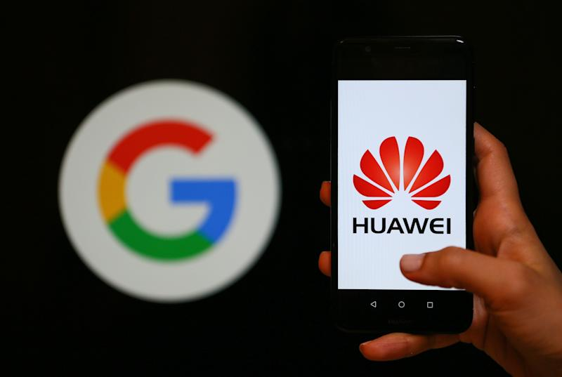 IZMIR, TURKEY - MAY 28: A person holds a Huawei mobile phone in front of logo of Google in Izmir, Turkey on May 28, 2019. (Photo by Emin Menguarslan/Anadolu Agency/Getty Images)