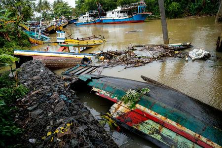 Destroyed boats are seen after a tsunami hit an area near Carita in Pandeglang, Banten province, Indonesia, December 24, 2018. REUTERS/Jorge Silva