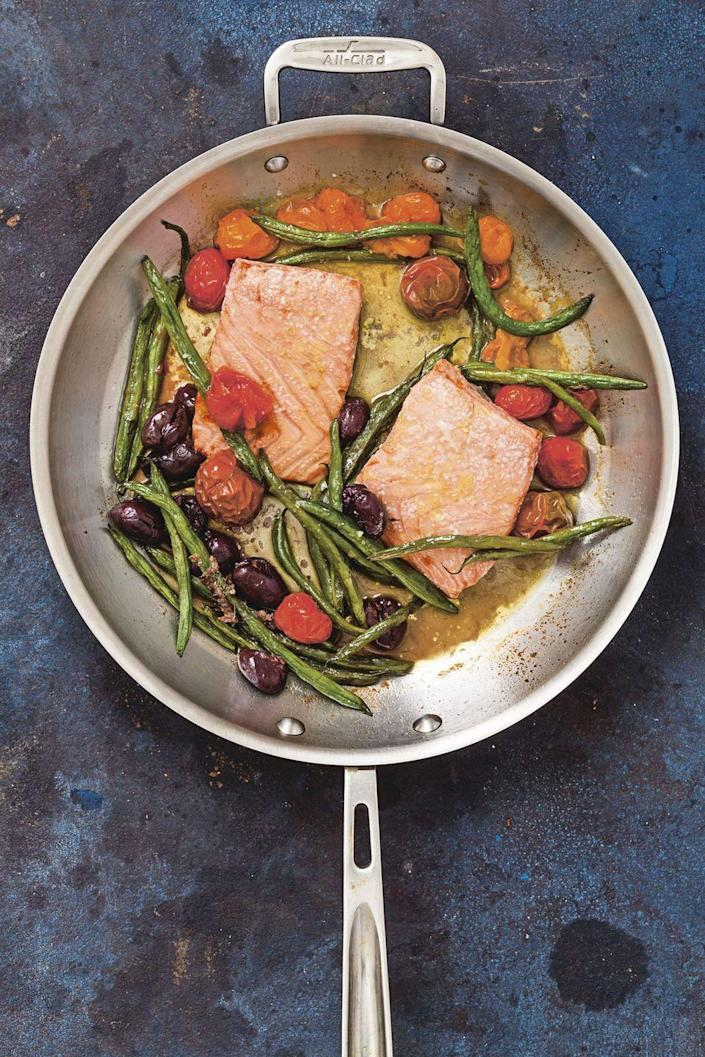 """<p>Turn five ingredients into a shockingly mouthwatering Mediterranean plate.<br></p><p><em><a href=""""https://www.goodhousekeeping.com/food-recipes/easy/a24179295/roasted-salmon-with-tomatoes-and-green-beans-recipe/"""" rel=""""nofollow noopener"""" target=""""_blank"""" data-ylk=""""slk:Get the recipe for Roasted Salmon with Tomatoes and Green Beans »"""" class=""""link rapid-noclick-resp"""">Get the recipe for Roasted Salmon with Tomatoes and Green Beans »</a></em><strong><br></strong></p><p><strong>RELATED</strong>: <a href=""""https://www.goodhousekeeping.com/food-recipes/healthy/g448/salmon-recipes/"""" rel=""""nofollow noopener"""" target=""""_blank"""" data-ylk=""""slk:30+ Easy Salmon Recipes You'll Love"""" class=""""link rapid-noclick-resp"""">30+ Easy Salmon Recipes You'll Love</a></p>"""