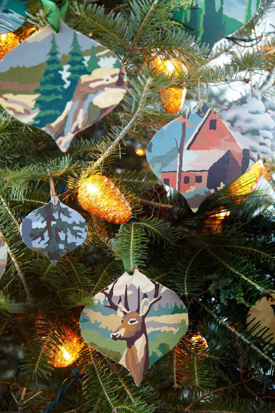 """<p>A dime a dozen at flea markets, a few of these amateur paintings can yield scads of one-of-a-kind tree trimmers. """"I've always been inspired by the shape of vintage ornaments,"""" says <a href=""""https://www.countryliving.com/home-design/decorating-ideas/g1570/serena-thompson-christmas-decorating-ideas/#slide-3"""" rel=""""nofollow noopener"""" target=""""_blank"""" data-ylk=""""slk:the creator"""" class=""""link rapid-noclick-resp"""">the creator</a>, who cut out the silhouettes using heavy-duty scissors.</p><p><strong><a href=""""https://www.countryliving.com/ornament"""" rel=""""nofollow noopener"""" target=""""_blank"""" data-ylk=""""slk:Get the template."""" class=""""link rapid-noclick-resp"""">Get the template.</a></strong></p>"""