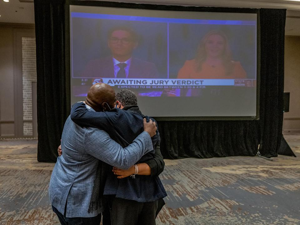 """Members of George Floyd's family and legal team hug after the guilty verdict is called in the trial of former police officer Derek Chauvin in Minneapolis, on April 20.<span class=""""copyright"""">Ruddy Roye for TIME</span>"""