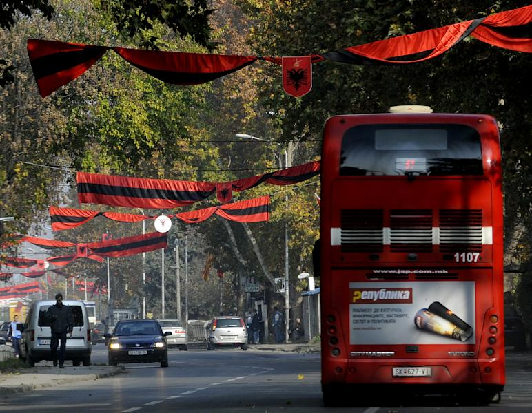 Red and black flags with Albanian coat of arms hang over a street in Macedonia's capital Skopje, on Saturday, Nov.24, 2012. Macedonian capital Skopje, particularly the parts populated with ethnic Albanians, are flooded with Albanian flags, in the eve of the celebration of 100 years of Albania's independence and the national flag. Ethnic Albanians make up a quarter of Macedonia's 2.1 million people and are the largest ethnic minority in the country. (AP Photo/Boris Grdanoski)