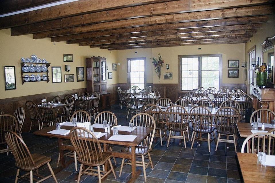 """<p>Antiques and handmade trinkets serve as the decor in this <a href=""""https://www.tripadvisor.com/Restaurant_Review-g38394-d2206827-Reviews-Breitbach_s_Family_Dining-Sherrill_Iowa.html"""" rel=""""nofollow noopener"""" target=""""_blank"""" data-ylk=""""slk:rustic restaurant"""" class=""""link rapid-noclick-resp"""">rustic restaurant</a>. It's been a Sherrill staple since 1852, though it burned down and was rebuilt more than once since opening. Dig into German classics like sauerkraut and sausage, as well as homemade pies.</p>"""